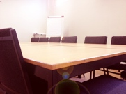 Tables chairs flip chart nice training room