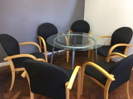 Glass table with seven chairs